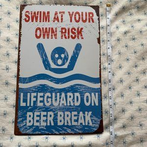 SWIM AT YOUR OWN RISK NOVELTY SIGN